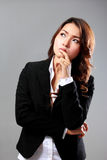 Young businesswoman thinking, looking above Stock Photography