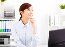 Young  businesswoman thinking in the office Stock Photos