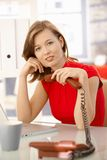 Young businesswoman thinking with phone in hand Royalty Free Stock Photo