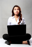 Young businesswoman thinking while working with a laptop Stock Images