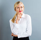 Young businesswoman in a thoughtful pose Stock Photos