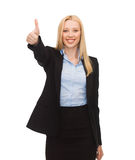 Young businesswoman with thumbs up Stock Images