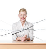 Young businesswoman tied with phone wire Stock Images