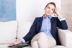 Young businesswoman tired on couch Royalty Free Stock Images