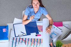 Young businesswoman tired from work in the office Royalty Free Stock Images