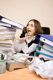 Young businesswoman with tons of documents. Screaming royalty free stock photo