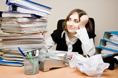 Young businesswoman with tons of documents Royalty Free Stock Image