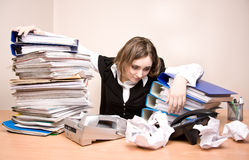 Young businesswoman with tons of documents. At office royalty free stock images
