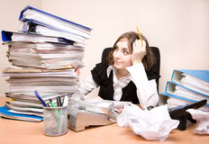 Young businesswoman with tons of documents Royalty Free Stock Photo