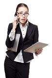 Young businesswoman totally busy Stock Image