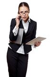Young businesswoman totally busy Royalty Free Stock Image
