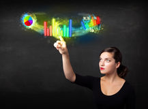 Young businesswoman touching colorful modern graph system concep Royalty Free Stock Photo