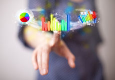 Young businesswoman touching colorful modern graph system concep Royalty Free Stock Photos