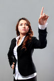 Young businesswoman touching a screen to presenting a presentati Stock Photography