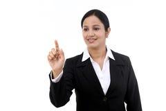 Young businesswoman touching virtual screen Stock Image