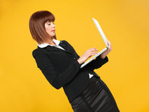 Young businesswoman typing on her laptop Stock Images