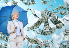 Young businesswoman with umbrella outdoors royalty free stock photography