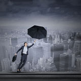Young businesswoman with umbrella Royalty Free Stock Photo