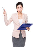 Young Businesswoman use of the clipboard and pen pointing up Stock Image