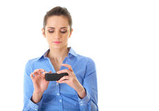 Young businesswoman use her smartphone, isolated Stock Photos