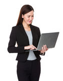 Young businesswoman use of laptop computer Stock Images