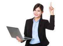 Young businesswoman use of the laptop and finger point up Stock Photo