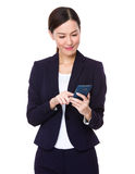 Young businesswoman use of mobile phone Stock Photo