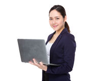 Young businesswoman use of the notebook computer Royalty Free Stock Image