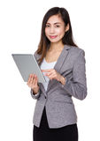 Young businesswoman use of tablet Royalty Free Stock Images