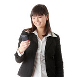 Young businesswoman using cell phone Stock Images