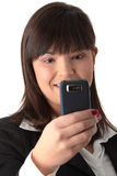 Young businesswoman using cell phone Royalty Free Stock Image