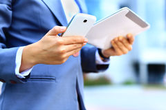 Young businesswoman using digital tablet and mobile phone stock photos