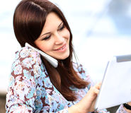 Young businesswoman using digital tablet and mobile phone Royalty Free Stock Photos