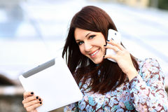 Young businesswoman using digital tablet and mobile phone Royalty Free Stock Image