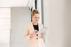 Young businesswoman using digital tablet in new office Royalty Free Stock Photo
