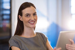 Young businesswoman using digital tablet in office Royalty Free Stock Image