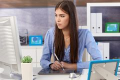 Young businesswoman using drawing pad stock photography