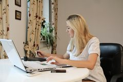 Young businesswoman using graphics tablet Royalty Free Stock Image