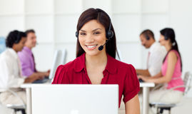 Young Businesswoman using headset. In a call center Stock Photos