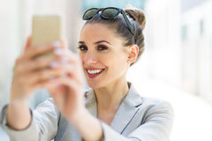 Young businesswoman using her smartphone Stock Images