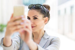 Young businesswoman using her smartphone Stock Photo