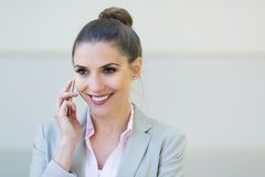 Young businesswoman using her smartphone Stock Photography