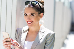 Young businesswoman using her smartphone Royalty Free Stock Image