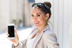 Young businesswoman using her smartphone Stock Photos