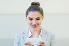 Young businesswoman using her smartphone Stock Image