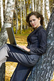 Young businesswoman using laptop. Stock Image