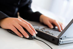 Young businesswoman using laptop Stock Photo