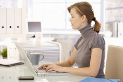 Young businesswoman using laptop Royalty Free Stock Image