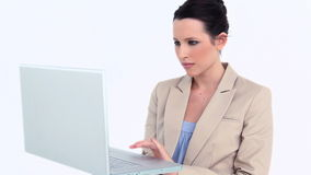 Young businesswoman using a laptop Stock Photo