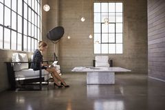 Young businesswoman using laptop in business foyer, close up stock images